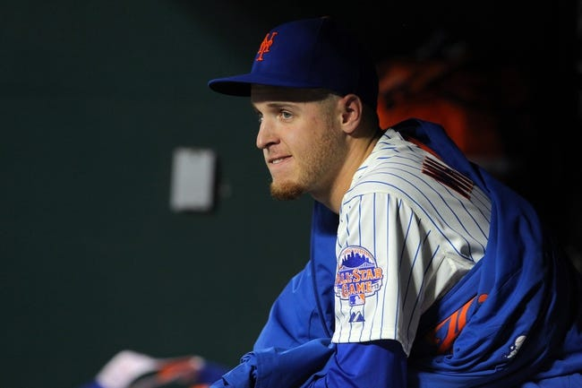 Aug 26, 2013; New York, NY, USA; New York Mets starting pitcher Zack Wheeler (45) looks on from the dugout during the second inning of a game against the Philadelphia Phillies at Citi Field. Mandatory Credit: Brad Penner-USA TODAY Sports