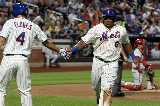 Aug 26, 2013; New York, NY, USA; New York Mets right fielder Marlon Byrd (6) is congratulated by third baseman Wilmer Flores (4) after scoring a run against the Philadelphia Phillies during the second inning of a game at Citi Field. Mandatory Credit: Brad Penner-USA TODAY Sports