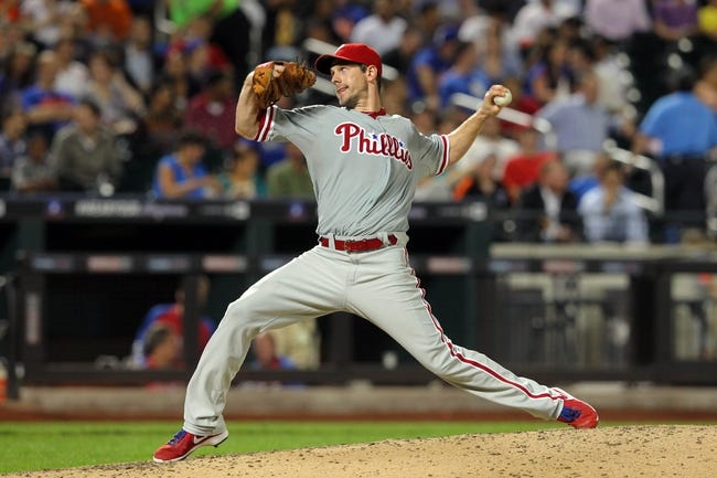 Aug 26, 2013; New York, NY, USA; Philadelphia Phillies starting pitcher Cliff Lee (33) pitches against the New York Mets during the sixth inning of a game at Citi Field. The Phillies defeated the Mets 2-1. Mandatory Credit: Brad Penner-USA TODAY Sports