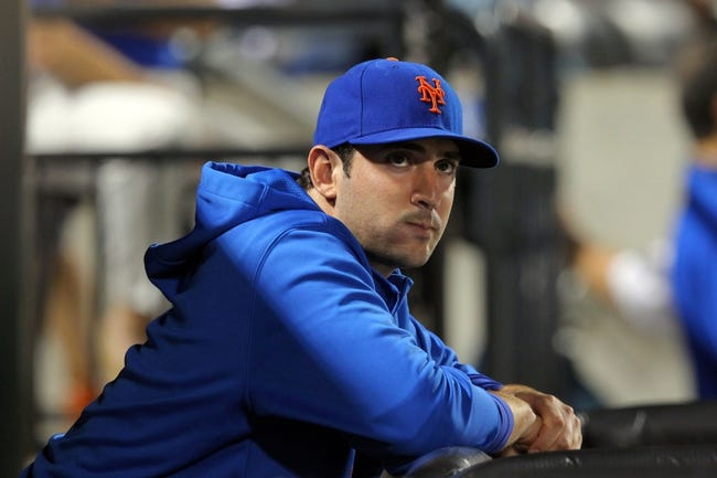 Aug 26, 2013; New York, NY, USA; New York Mets injured starting pitcher Matt Harvey (33) looks on from the dugout during the eighth inning of a game against the Philadelphia Phillies at Citi Field. The Phillies defeated the Mets 2-1. Mandatory Credit: Brad Penner-USA TODAY Sports