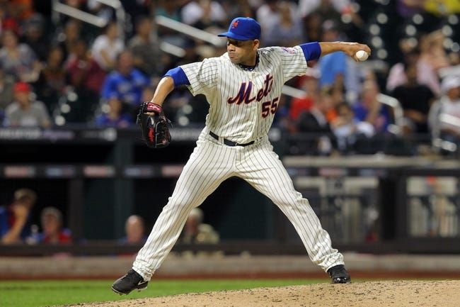 Aug 26, 2013; New York, NY, USA; New York Mets relief pitcher Pedro Feliciano (55) pitches against the Philadelphia Phillies during the seventh inning of a game at Citi Field. The Phillies defeated the Mets 2-1. Mandatory Credit: Brad Penner-USA TODAY Sports