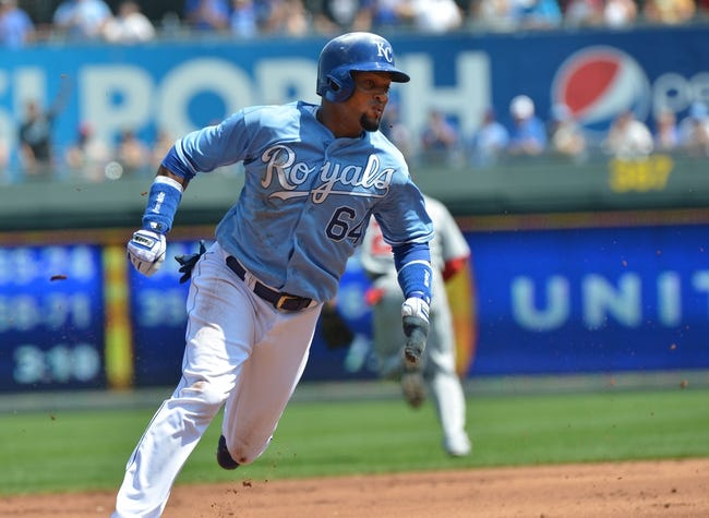 Aug 25, 2013; Kansas City, MO, USA; Kansas City Royals second basemen Emilio Bonifacio (64) scores as he rounds third base against the Washington Nationals during the first inning at Kauffman Stadium.  Mandatory Credit: Peter G. Aiken-USA TODAY Sports
