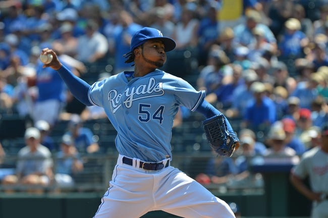 Aug 25, 2013; Kansas City, MO, USA; Kansas City Royals pitcher Ervin Santana (54) delivers a pitch against the Washington Nationals during the first inning at Kauffman Stadium.  Mandatory Credit: Peter G. Aiken-USA TODAY Sports
