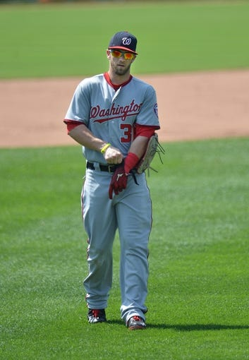 Aug 25, 2013; Kansas City, MO, USA; Washington Nationals right fielder Bryce Harper (34) walks into the out field in between innings against the Kansas City Royals at Kauffman Stadium.  Mandatory Credit: Peter G. Aiken-USA TODAY Sports