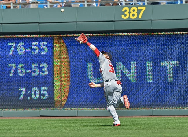 Aug 25, 2013; Kansas City, MO, USA; Washington Nationals right fielder Bryce Harper (34) makes a running catch against the Kansas City Royals during the seventh inning at Kauffman Stadium.  Kansas City won 6-4.  Mandatory Credit: Peter G. Aiken-USA TODAY Sports