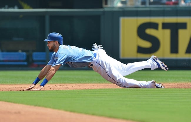 Aug 25, 2013; Kansas City, MO, USA; Kansas City Royals first basemen Eric Hosmer (35) dives into second on an attempted steal against the Washington Nationals during the first inning at Kauffman Stadium.  Mandatory Credit: Peter G. Aiken-USA TODAY Sports