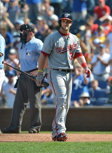 Aug 25, 2013; Kansas City, MO, USA; Washington Nationals right fielder Bryce Harper (34) walks back to the dugout after striking out against the Kansas City Royals during the ninth inning at Kauffman Stadium.  Kansas City won 6-4.  Mandatory Credit: Peter G. Aiken-USA TODAY Sports
