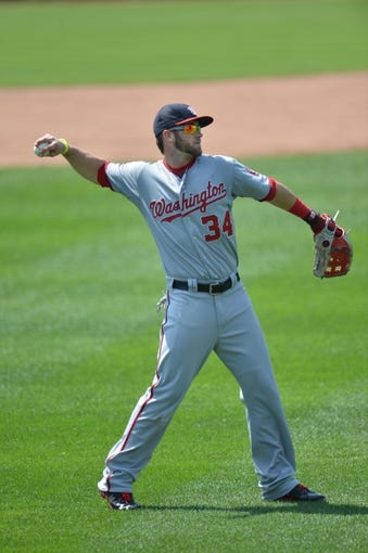 Aug 25, 2013; Kansas City, MO, USA; Washington Nationals right fielder Bryce Harper (34) warms up in between innings against the Kansas City Royals at Kauffman Stadium.  Mandatory Credit: Peter G. Aiken-USA TODAY Sports