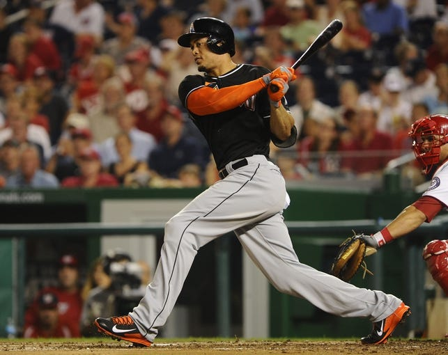 Aug 27, 2013; Washington, DC, USA; Miami Marlins right fielder Giancarlo Stanton (27) hits a double during the fourth inning against the Washington Nationals at Nationals Park.  Mandatory Credit: Brad Mills-USA TODAY Sports