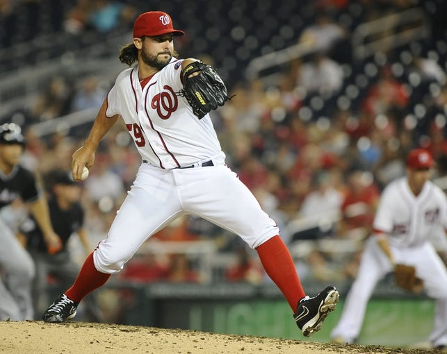 Aug 27, 2013; Washington, DC, USA; Washington Nationals relief pitcher Tanner Roark (59) throws during the sixth inning against the Miami Marlins at Nationals Park. Mandatory Credit: Brad Mills-USA TODAY Sports