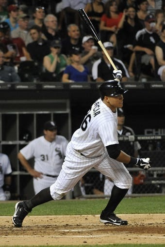 Aug 27, 2013; Chicago, IL, USA; Chicago White Sox right fielder Avisail Garcia (26) hits an RBI single against the Houston Astros during the fourth inning at U.S. Cellular Field. Mandatory Credit: David Banks-USA TODAY Sports