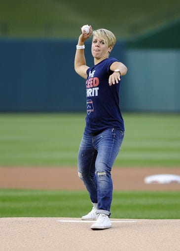 Aug 27, 2013; Washington, DC, USA; Professional soccer player Lori Lindsey throws out the ceremonial first pitch  before the game between the Miami Marlins and Washington Nationals at Nationals Park. Mandatory Credit: Brad Mills-USA TODAY Sports