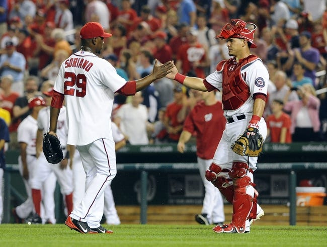 Aug 27, 2013; Washington, DC, USA; Washington Nationals relief pitcher Rafael Soriano (29) is congratulated by catcher Wilson Ramos (40) after earning a save against the Miami Marlins at Nationals Park. Mandatory Credit: Brad Mills-USA TODAY Sports