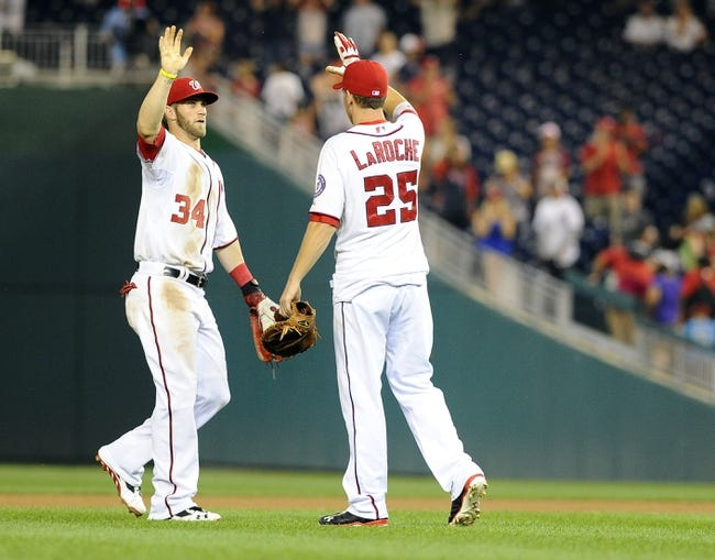 Aug 27, 2013; Washington, DC, USA; Washington Nationals left fielder Bryce Harper (34) and Adam LaRoche (25) congratulate each other after the final out against the Miami Marlins at Nationals Park. Mandatory Credit: Brad Mills-USA TODAY Sports