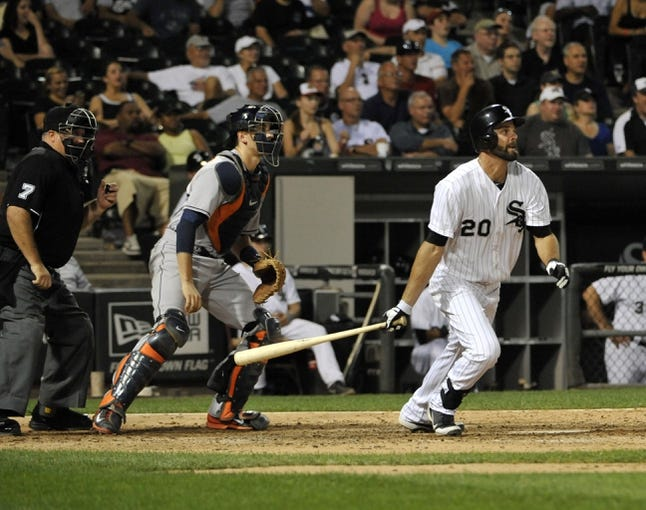 Aug 27, 2013; Chicago, IL, USA; Chicago White Sox center fielder Jordan Danks (20) hits a go ahead two-RBI single against the Houston Astros during the eighth inning at U.S. Cellular Field. The Chicago White Sox defeated the Houston Astros 4-3. Mandatory Credit: David Banks-USA TODAY Sports