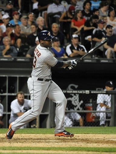 Aug 27, 2013; Chicago, IL, USA; Houston Astros designated hitter Chris Carter (23) hits an RBI single against the Chicago White Sox during the eighth inning at U.S. Cellular Field. The Chicago White Sox defeated the Houston Astros 4-3. Mandatory Credit: David Banks-USA TODAY Sports
