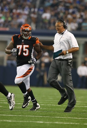 Aug 24, 2013; Arlington, TX, USA; Cincinnati Bengals defensive line coach Jay Hayes runs in the call with defensive tackle Devon Still (75) against the Dallas Cowboys at AT&T Stadium. Mandatory Credit: Matthew Emmons-USA TODAY Sports