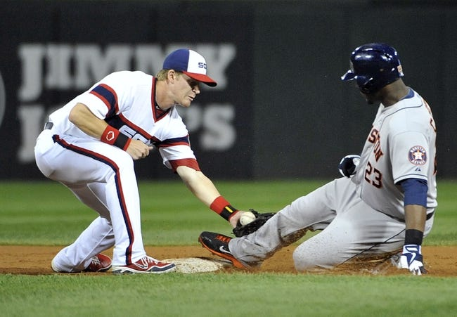 Aug 28, 2013; Chicago, IL, USA; Houston Astros first baseman Chris Carter (23) slides safely with a double as Chicago White Sox second baseman Gordon Beckham (15) makes a tag during the second inning at U.S. Cellular Field.  Mandatory Credit: David Banks-USA TODAY Sports