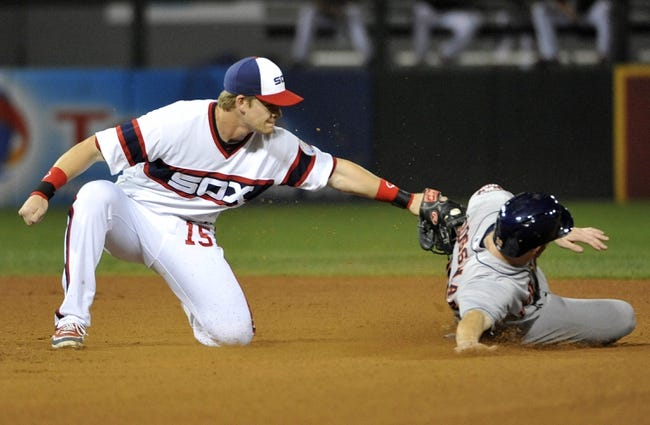Aug 28, 2013; Chicago, IL, USA; Chicago White Sox second baseman Gordon Beckham (15) tags out Houston Astros left fielder Robbie Grossman (19) on a stolen base attempt during the sixth inning at U.S. Cellular Field.  Mandatory Credit: David Banks-USA TODAY Sports