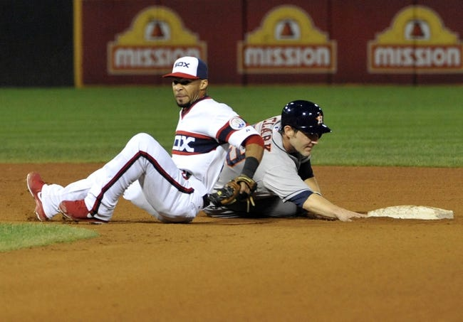 Aug 28, 2013; Chicago, IL, USA; Chicago White Sox shortstop Leury Garcia (28) forces out Houston Astros catcher Cody Clark (39) during the sixth inning at U.S. Cellular Field.  Mandatory Credit: David Banks-USA TODAY Sports
