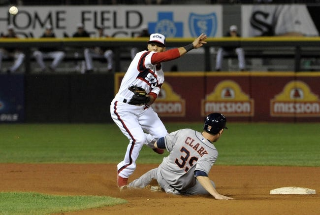 Aug 28, 2013; Chicago, IL, USA; Chicago White Sox shortstop Leury Garcia (28) forces out Houston Astros catcher Cody Clark (39) and throws to first base during the sixth inning at U.S. Cellular Field.  Mandatory Credit: David Banks-USA TODAY Sports