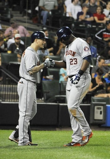 Aug 28, 2013; Chicago, IL, USA; Houston Astros first baseman Chris Carter (23) is greeted by center fielder Brandon Barnes (2) after hitting a home run against the Chicago White Sox during the seventh inning at U.S. Cellular Field.  Mandatory Credit: David Banks-USA TODAY Sports