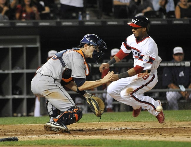 Aug 28, 2013; Chicago, IL, USA;  Chicago White Sox shortstop Leury Garcia (28) scores ahead of the tag from Houston Astros catcher Cody Clark (39) during the seventh inning at U.S. Cellular Field.  Mandatory Credit: David Banks-USA TODAY Sports