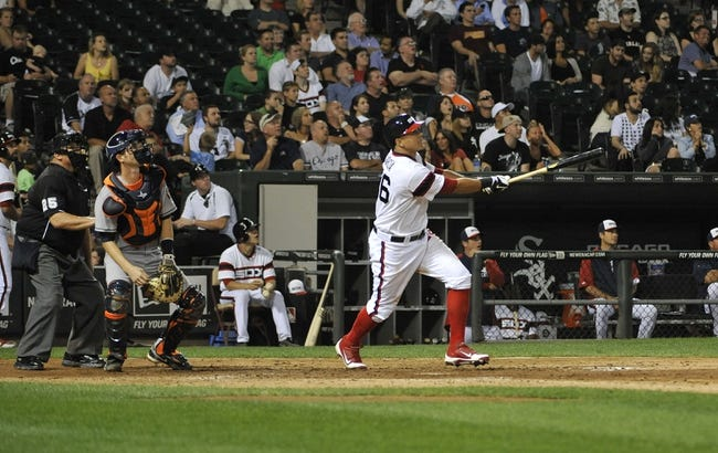 Aug 28, 2013; Chicago, IL, USA;  Chicago White Sox center fielder Avisail Garcia (26) hits a three-run homer against the Houston Astros during the seventh inning at U.S. Cellular Field.  Mandatory Credit: David Banks-USA TODAY Sports