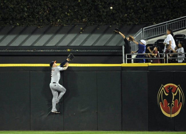 Aug 28, 2013; Chicago, IL, USA; Houston Astros center fielder Brandon Barnes (2) tries to catch a three run homer off the bat of Chicago White Sox center fielder Avisail Garcia (not pictured) during the seventh inning at U.S. Cellular Field.  Mandatory Credit: David Banks-USA TODAY Sports