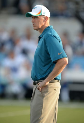 Aug 4, 2013; Canton, OH, USA; Miami Dolphins coach Joe Philbin reacts during the 2013 Hall of Fame Game against the Dallas Cowboys at Fawcett Stadium. The Cowboys defeated the Dolphins 24-20. Mandatory Credit: Kirby Lee-USA TODAY Sports