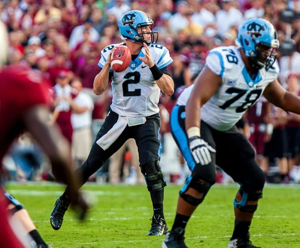 Aug 29, 2013; Columbia, SC, USA; North Carolina Tar Heels quarterback Bryn Renner (2) looks to pass against the South Carolina Gamecocks in the second quarter at Williams-Brice Stadium. Mandatory Credit: Jeff Blake-USA TODAY Sports