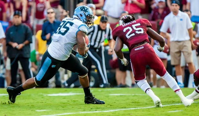 Aug 29, 2013; Columbia, SC, USA; North Carolina Tar Heels defensive tackle Greg Webb (58) makes a reception in front of South Carolina Gamecocks safety Kadetrix Marcus (25) in the second quarter at Williams-Brice Stadium. Mandatory Credit: Jeff Blake-USA TODAY Sports