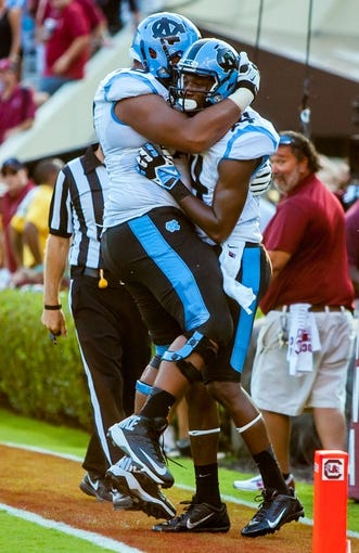 Aug 29, 2013; Columbia, SC, USA; North Carolina Tar Heels guard Landon Turner (78) and wide receiver Quinshad Davis (14) celebrate a Davis touchdown against the South Carolina Gamecocks in the second quarter at Williams-Brice Stadium. Mandatory Credit: Jeff Blake-USA TODAY Sports