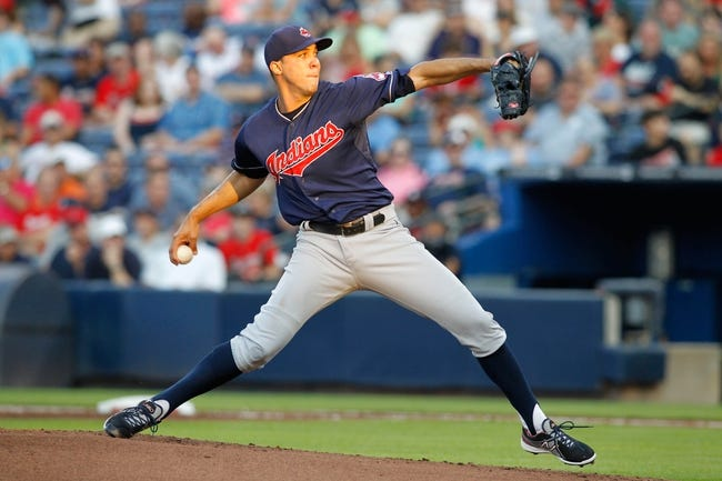 Aug 29, 2013; Atlanta, GA, USA; Cleveland Indians starting pitcher Ubaldo Jimenez (30) throws a pitch against the Atlanta Braves in the first inning at Turner Field. Mandatory Credit: Brett Davis-USA TODAY Sports