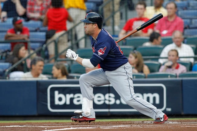 Aug 29, 2013; Atlanta, GA, USA; Cleveland Indians second baseman Jason Kipnis (22) hits a single against the Atlanta Braves in the first inning at Turner Field. Mandatory Credit: Brett Davis-USA TODAY Sports