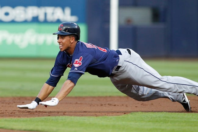 Aug 29, 2013; Atlanta, GA, USA; Cleveland Indians left fielder Michael Brantley (23) slides into second base against the Atlanta Braves in the second inning at Turner Field. Mandatory Credit: Brett Davis-USA TODAY Sports