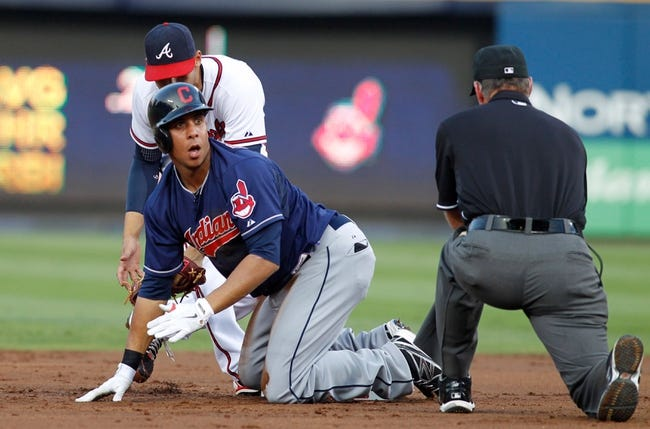 Aug 29, 2013; Atlanta, GA, USA; Cleveland Indians left fielder Michael Brantley (23) reacts after being tagged out by Atlanta Braves shortstop Andrelton Simmons (19) in the second inning at Turner Field. Mandatory Credit: Brett Davis-USA TODAY Sports