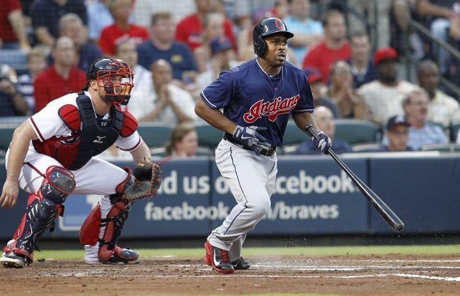 Aug 29, 2013; Atlanta, GA, USA; Cleveland Indians center fielder Michael Bourn (24) singles against the Atlanta Braves in the third inning at Turner Field. Mandatory Credit: Brett Davis-USA TODAY Sports