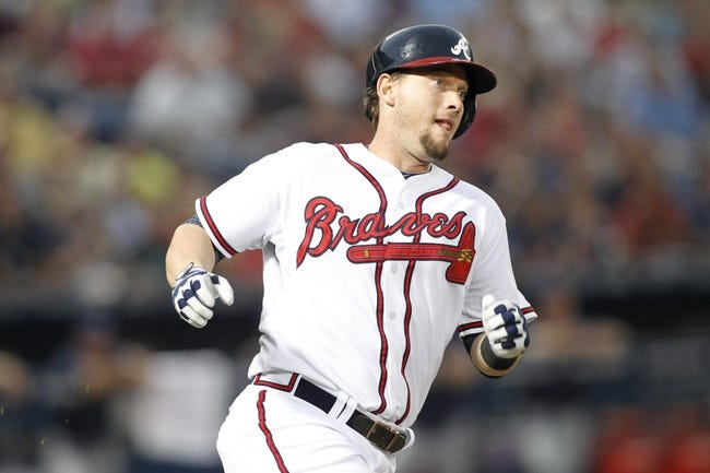 Aug 29, 2013; Atlanta, GA, USA; Atlanta Braves third baseman Chris Johnson (23) hits a double against the Cleveland Indians in the third inning at Turner Field. Mandatory Credit: Brett Davis-USA TODAY Sports