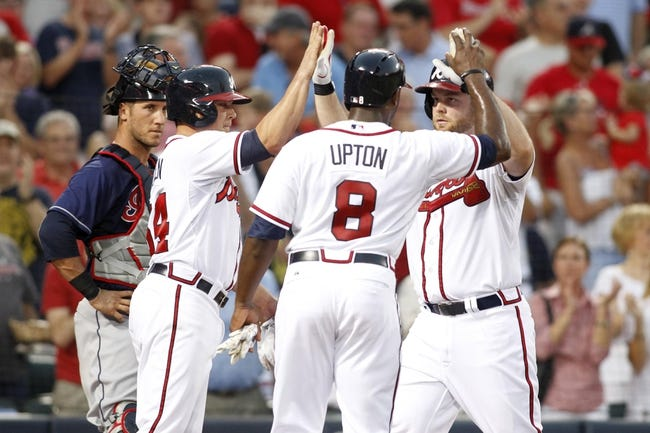 Aug 29, 2013; Atlanta, GA, USA; Atlanta Braves starting pitcher Kris Medlen (54) and left fielder Justin Upton (8) congratulate catcher Brian McCann (16) after a home run against the Cleveland Indians in the third inning at Turner Field. Mandatory Credit: Brett Davis-USA TODAY Sports
