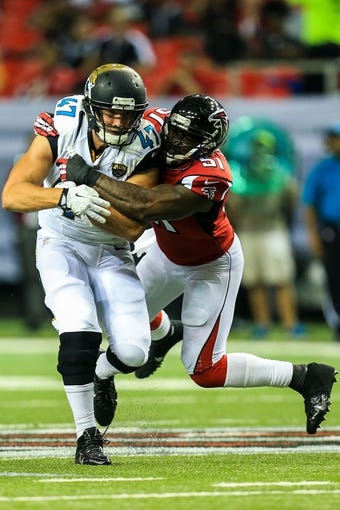 Aug 29, 2013; Atlanta, GA, USA; Jacksonville Jaguars tight end Brett Brackett (47) is tackled after a catch by Atlanta Falcons linebacker Robert James (51) in the second quarter at the Georgia Dome. Mandatory Credit: Daniel Shirey-USA TODAY Sports