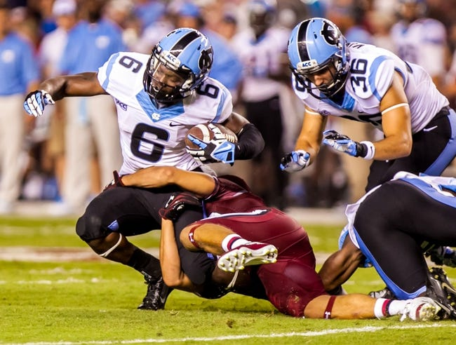 Aug 29, 2013; Columbia, SC, USA; North Carolina Tar Heels wide receiver Sean Tapley (6) is brought down by South Carolina Gamecocks cornerback Sidney Rhodes (30) in the third quarter at Williams-Brice Stadium. Mandatory Credit: Jeff Blake-USA TODAY Sports