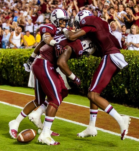 Aug 29, 2013; Columbia, SC, USA; South Carolina Gamecocks wide receiver Damiere Byrd (1) and running back Mike Davis (28) and wide receiver Shaq Roland (4) celebrate a 75 yard touchdown run by Davis against the North Carolina Tar Heels in the third quarter at Williams-Brice Stadium. Mandatory Credit: Jeff Blake-USA TODAY Sports