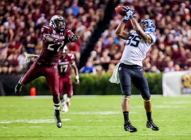 Aug 29, 2013; Columbia, SC, USA; North Carolina Tar Heels tight end Eric Ebron (85) makes a reception in front of South Carolina Gamecocks cornerback Victor Hampton (27) in the fourth quarter at Williams-Brice Stadium. Mandatory Credit: Jeff Blake-USA TODAY Sports
