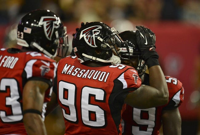 Aug 29, 2013; Atlanta, GA, USA; Atlanta Falcons defensive end Jonathan Massaquoi (96) celebrates with linebacker Joplo Bartu (59) after returning a fumble for a touchdown during the second quarter at the Georgia Dome. Mandatory Credit: Dale Zanine-USA TODAY Sports