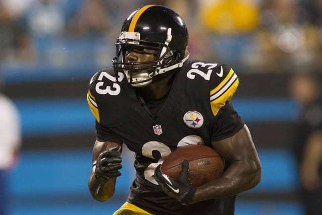 Aug 29, 2013; Charlotte, NC, USA; Pittsburgh Steelers Felix Jones (23) runs the ball during the third quarter against the Carolina Panthers at Bank of America Stadium. The Panthers defeated the Steelers 25-10. Mandatory Credit: Jeremy Brevard-USA TODAY Sports