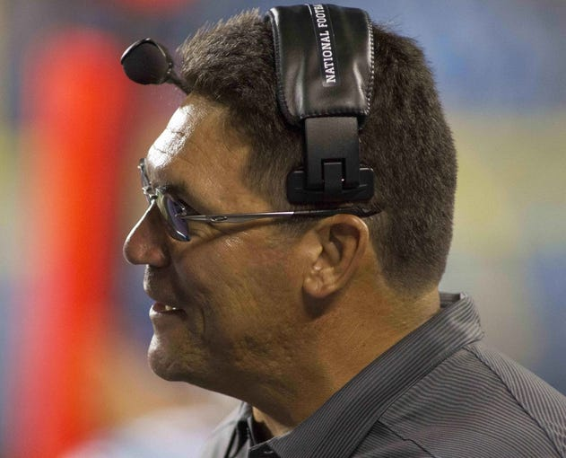 Aug 29, 2013; Charlotte, NC, USA; Carolina Panthers head coach Ron Rivera talks with a player during the fourth quarter against the Pittsburgh Steelers at Bank of America Stadium. The Panthers defeated the Steelers 25-10. Mandatory Credit: Jeremy Brevard-USA TODAY Sports