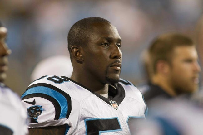 Aug 29, 2013; Charlotte, NC, USA; Carolina Panthers outside linebacker Thomas Davis (58) stands on the sidelines during the fourth quarter against the Pittsburgh Steelers at Bank of America Stadium. The Panthers defeated the Steelers 25-10. Mandatory Credit: Jeremy Brevard-USA TODAY Sports