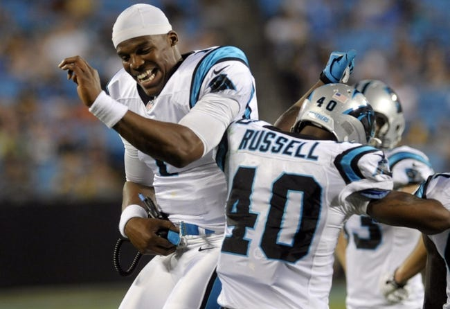 Aug 29, 2013; Charlotte, NC, USA; Carolina Panthers quarter Cam Newton (1) celebrates with safety Anderson Russell (40) after his team forces a safety during the game against the Pittsburgh Steelers at Bank Of America Stadium. Panthers win 25-10. Mandatory Credit: Sam Sharpe-USA TODAY Sports