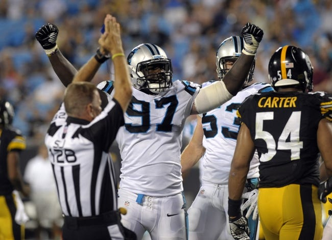 Aug 29, 2013; Charlotte, NC, USA; Carolina Panthers defensive end Mario Addison (97) celebrates after forcing a safety during the game against the Pittsburgh Steelers at Bank Of America Stadium. Panthers win 25-10. Mandatory Credit: Sam Sharpe-USA TODAY Sports
